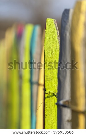Colorful garden fence - stock photo