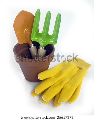colorful garden tools and flower pot on white background - stock photo