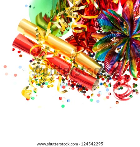 colorful garlands, streamer, cracker, party hats and confetti. festive decoration background