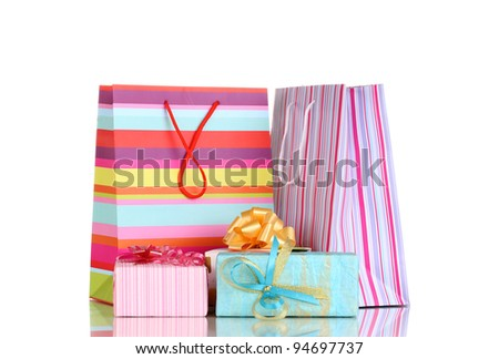 Colorful gift bags with gifts isolated on white - stock photo