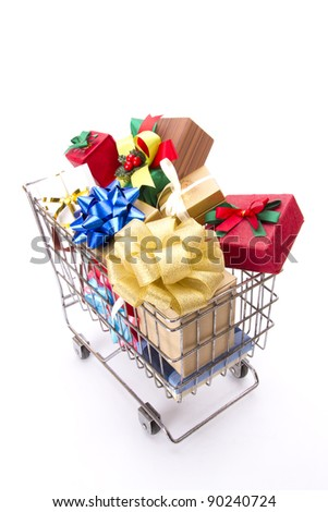 colorful gift boxes cart, many of greetings present boxes contain in a cart.