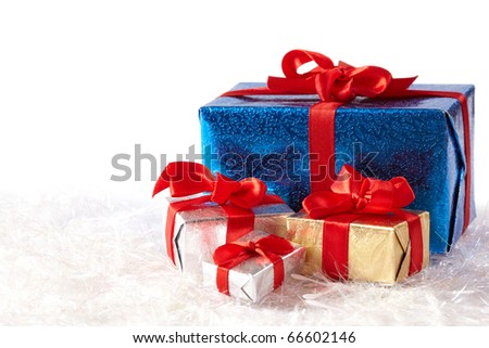 Colorful gift boxes on snow isolated on white background - stock photo