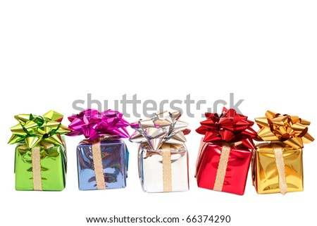 Colorful gift boxes with a bows for Christmas or Valentines Day isolated on white background with copy space - stock photo