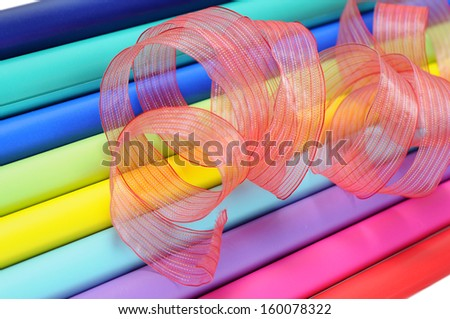 colorful gift wrap rolls and ribbon