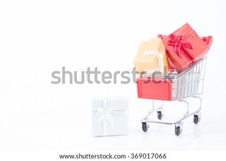 colorful gifts box,supermarket shopping cart - stock photo