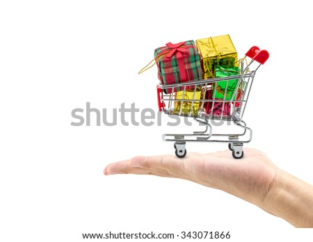 colorful gifts box,supermarket shopping cart with hand on white background - stock photo