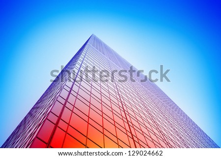 Colorful glass building facade - stock photo