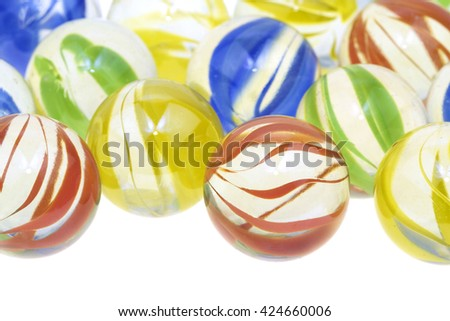 Colorful glass marbles  on white background