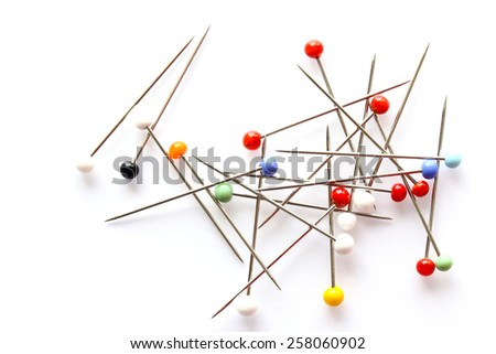 Colorful glass sewing pins isolated - stock photo
