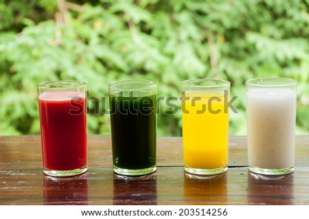 Colorful glasses of fruit and vegetable liquid for healthy - stock photo