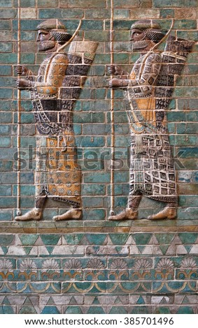 Colorful glazed brick frieze of Persian Achaemenid warriors from Susa of Iran. - stock photo