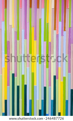 Colorful glossy tile on the wall of bathroom.