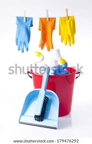 colorful gloves and cleaning detergents