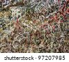 colorful graffiti scratchwork on a stone wall - stock photo