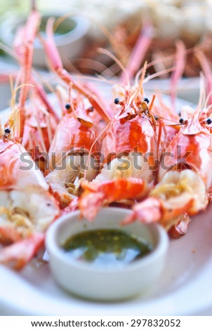 Colorful grilled shrimp with seafood sauce ready to be served. - stock photo
