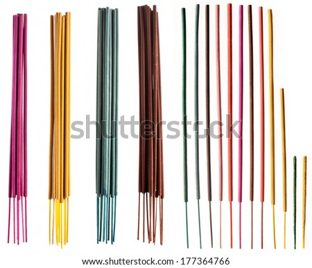 Colorful groups and individual incense sticks isolated on white background for an easy clipping. - stock photo