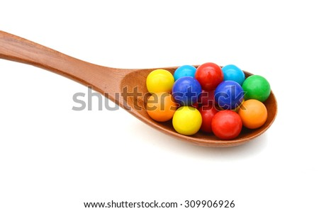 colorful gum balls isolated in wooden spoon on white background - stock photo