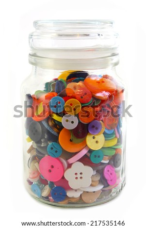 Colorful Haberdashery buttons in a glass jar. Vertical on White background.