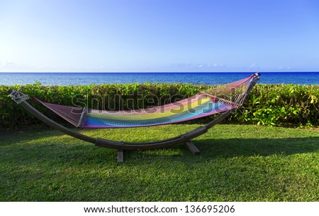 colorful hammock by the sea ready for use - stock photo