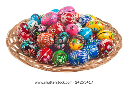 Colorful hand painted Easter Eggs in a wicker bowl