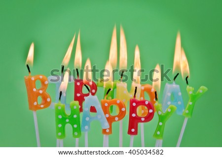 Colorful happy birthday candles with copy space - stock photo