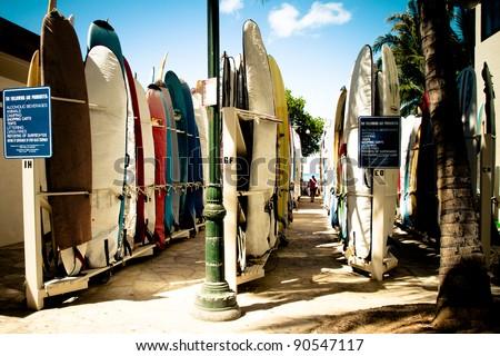 Colorful hawaiian surf boards parking rack in waikiki - stock photo
