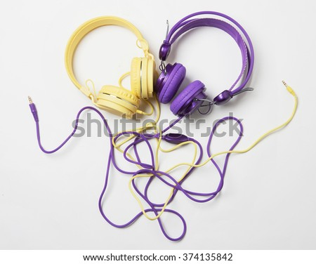 colorful headphones with complicated wires in pan - stock photo