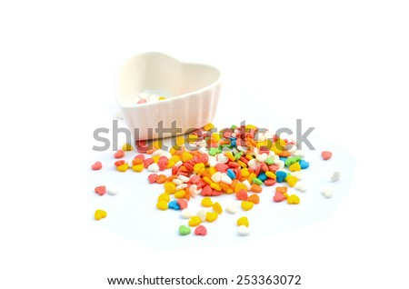 Colorful Heart Cake Sprinkles and Cup - stock photo