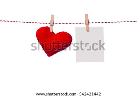 Colorful heart hanging on the clothesline on white background.
