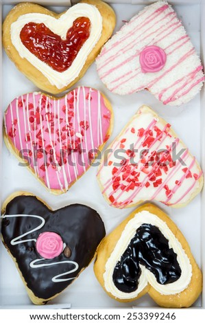 colorful heart shape donut in snack box - stock photo