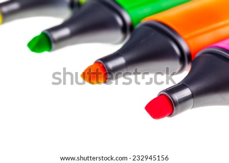 colorful highlighters or markers isolated over a white background - stock photo