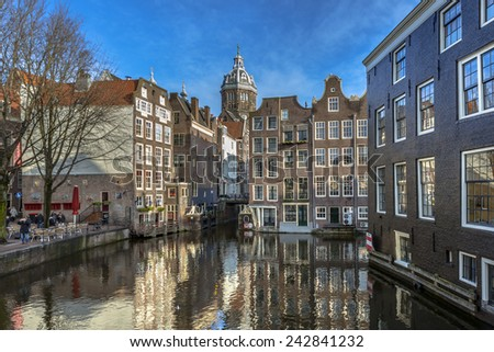 colorful historic canal houses seen from the armbrug in Amsterdam - stock photo