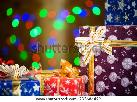 colorful holiday presents at abstract bokeh lights background