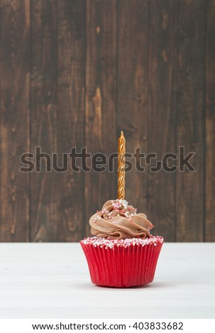 Colorful Homemade Birthday Cupcake With One Golden Candle. Copy Space - stock photo