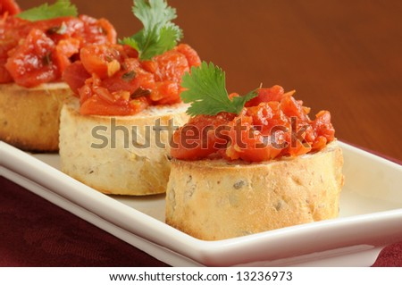 Colorful homemade delicious toasted bruschetta on a plate. - stock photo