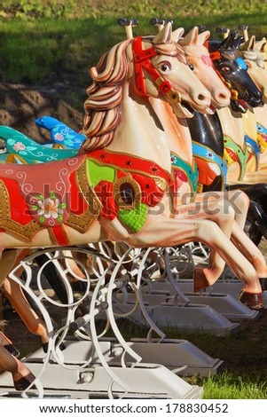 colorful horses on a carousel. - stock photo