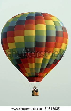 Colorful hot air balloon against sky.