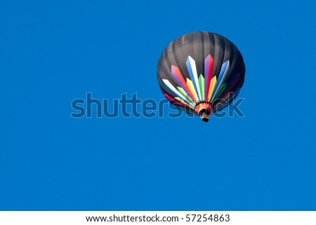 Colorful Hot Air Balloon Isolated on Clear Blue Sky