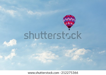 Colorful hot air balloon launched at the annual Metamora Country Days and Hot Air Balloon Festival. - stock photo