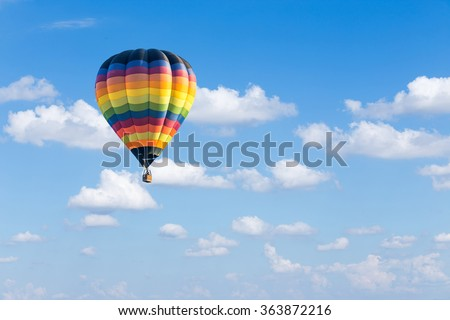 Colorful hot air balloon on blue sky background - stock photo