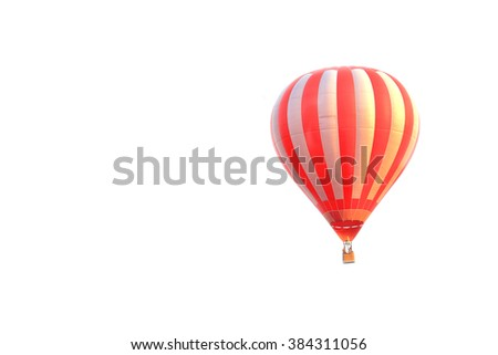 Colorful hot air balloon on white sky with copyspace - stock photo
