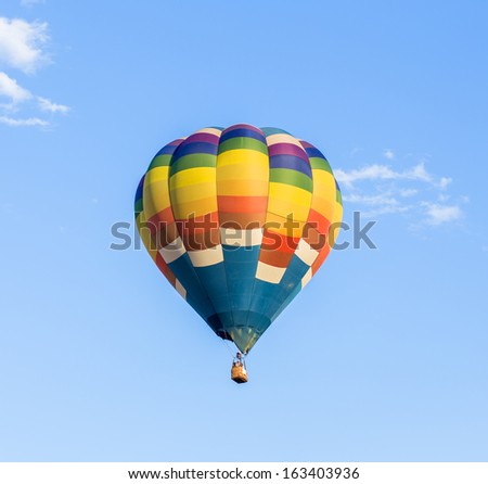 Colorful hot air balloon with blue sky background