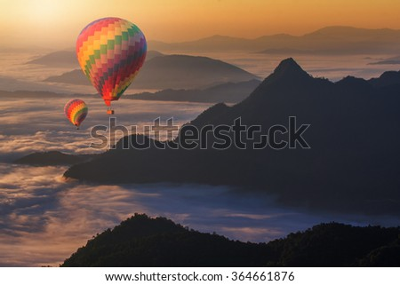 Colorful hot-air balloons and landscape  - stock photo