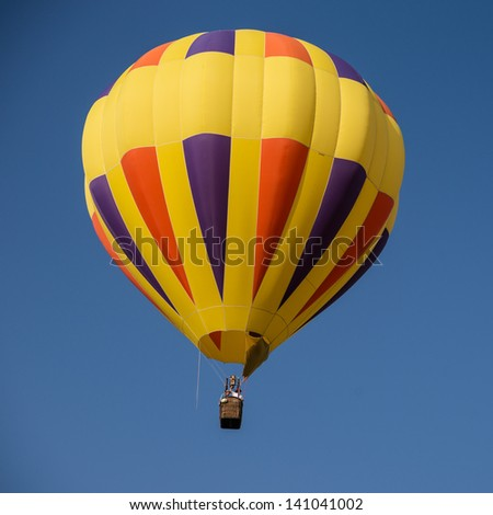 Colorful hot air balloons in flight over wine country at the Temecula Balloon and Wine Festival