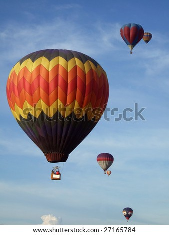 Colorful hot air balloons on the blue sky participating in the Malaysia Hot Air Balloon Festival - stock photo