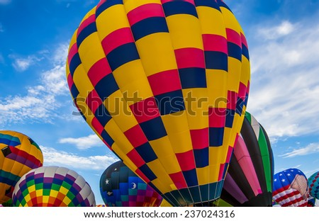 Colorful hot air balloons preparing for lift off. - stock photo