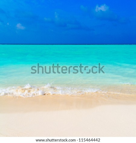 Colorful Hot Summer Landscape of Tropical Beach with Ocean Wave and White Sand - stock photo