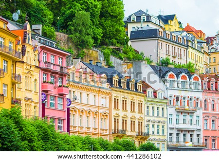 Colorful hotels and traditional buildings on sunny town of Karlovy Vary. The most visited spa town in the Czech Republic. - stock photo