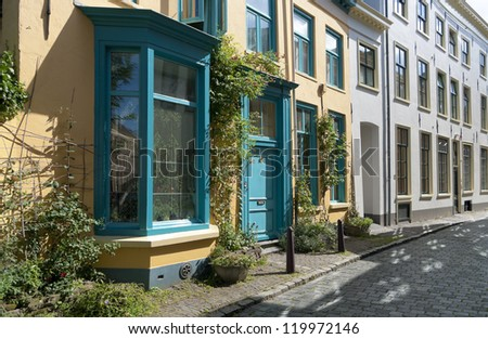colorful house in a street in zutphen, netherlands - stock photo