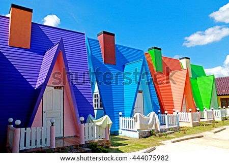 Colorful house in resort on blue sky - stock photo